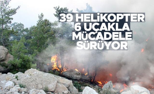 Muğla'da devam eden orman yangınlarında 11'inci güne girildi. 5 noktada devam eden orman yangınlarına sabahın ilk ışıkları ile havadan 39 helikopter, 6 uçak ile karadan Orman Genel Müdürlüğü'ne ait 342 arazöz, bin 843 personel, Türkiye'nin değişik illerinden gelen itfaiye ekipleri, su tankları ve gönüllüler ile müdahale devam ediyor.
