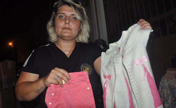 Doğmamış bebeğinin kıyafetlerini yangın zedelere gönderdi